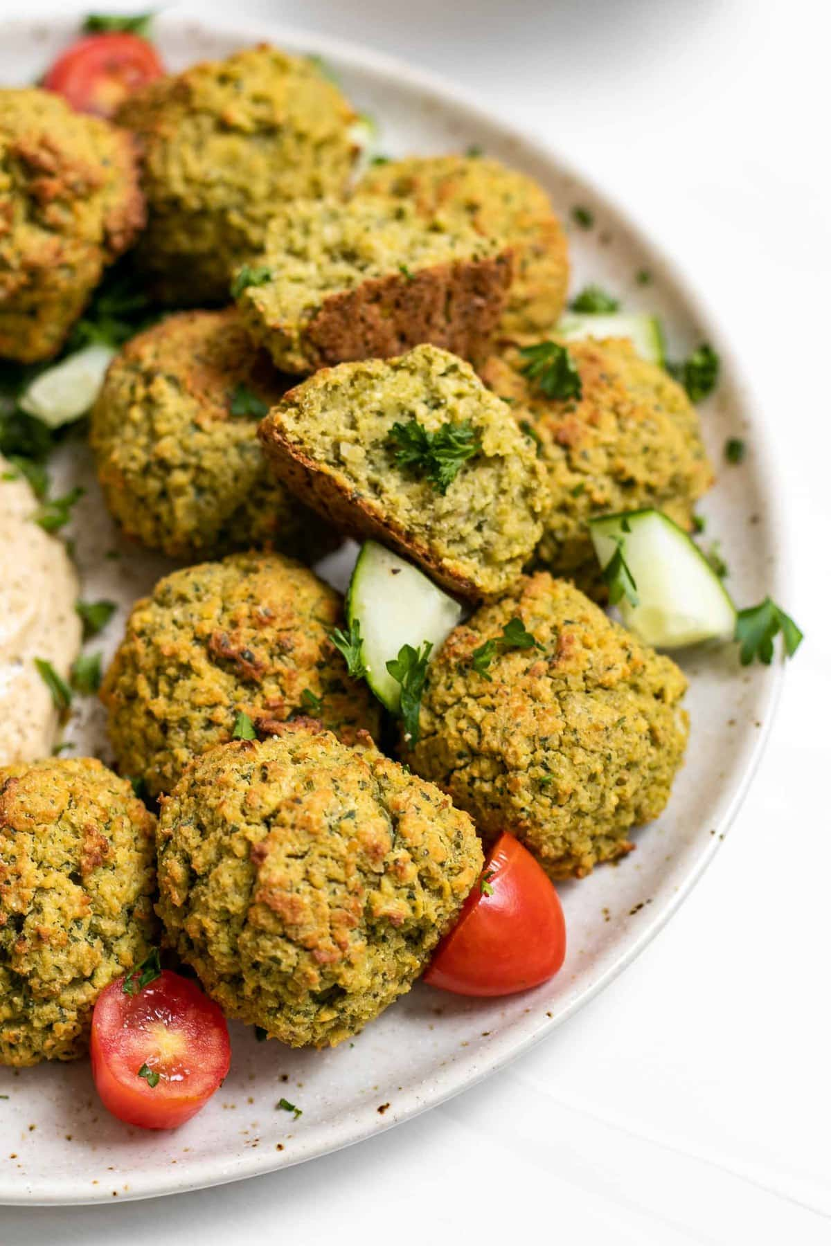 Vegan baked falafel recipe on a plate with parsley.