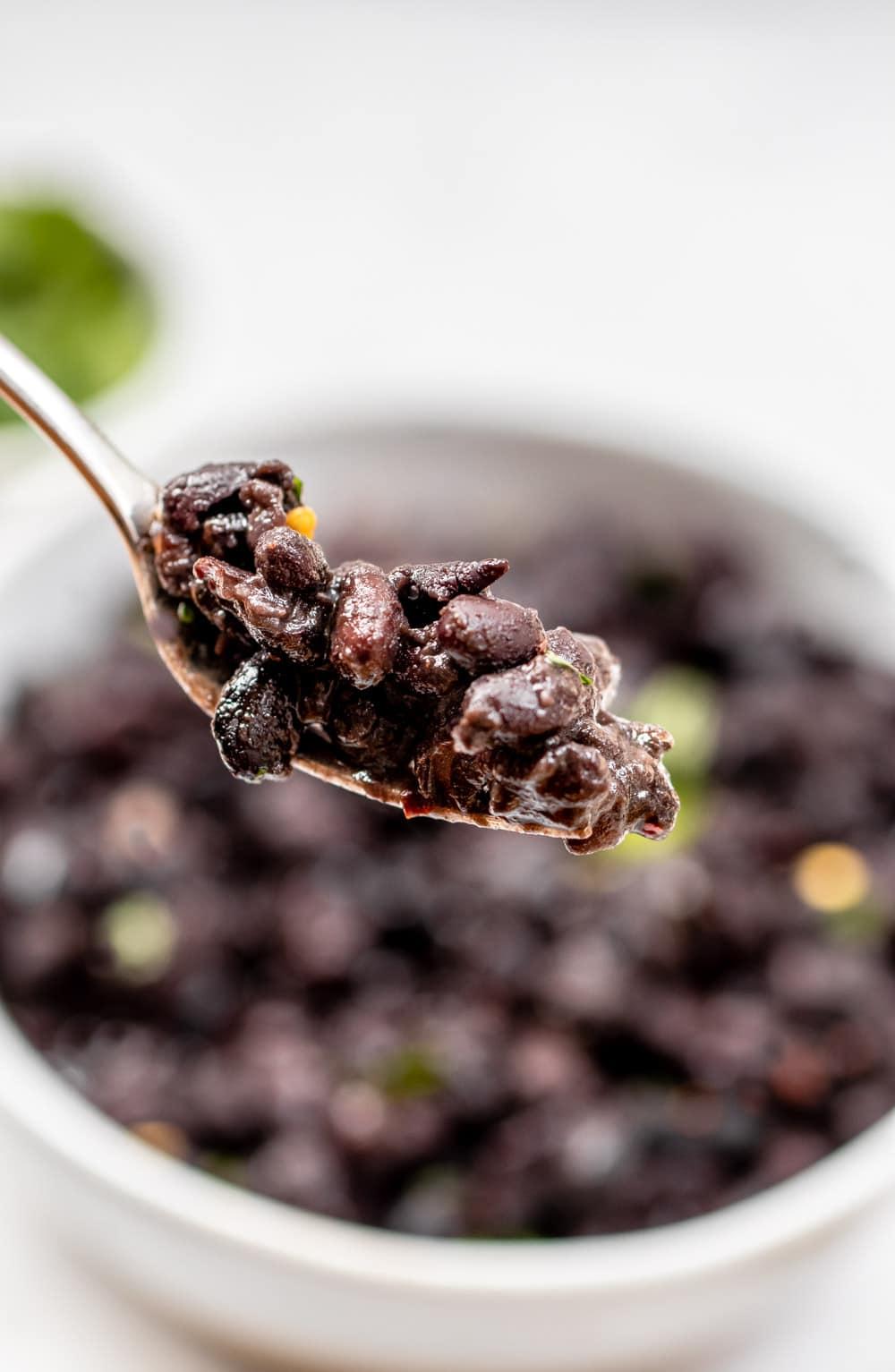 Instant pot black beans on a fork.