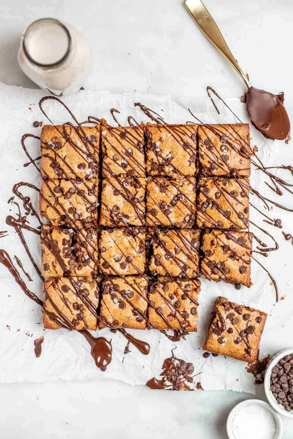 Gluten free blondies with chocolate drizzled on top.