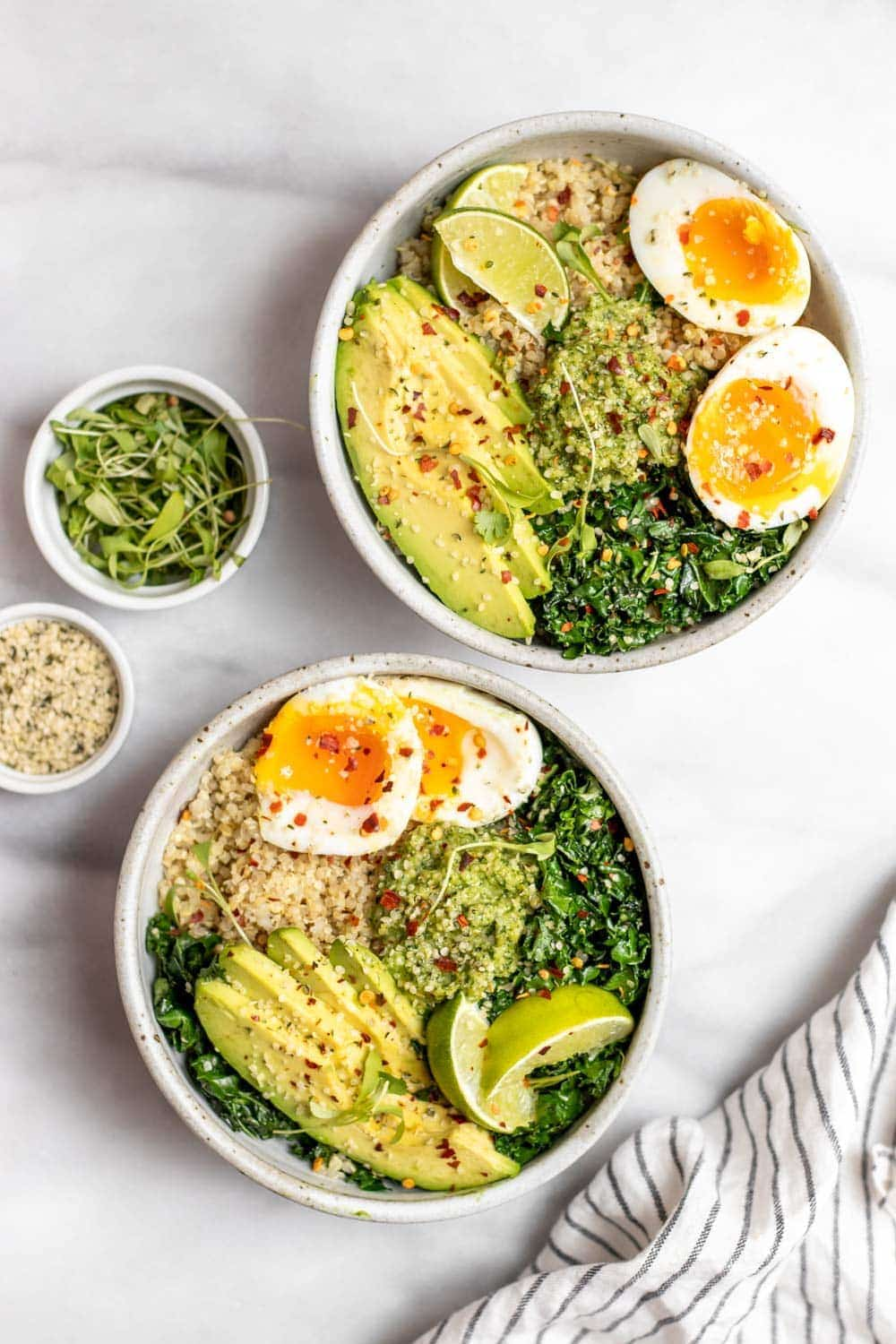 Quinoa breakfast bowl with kale, egg and avocado.