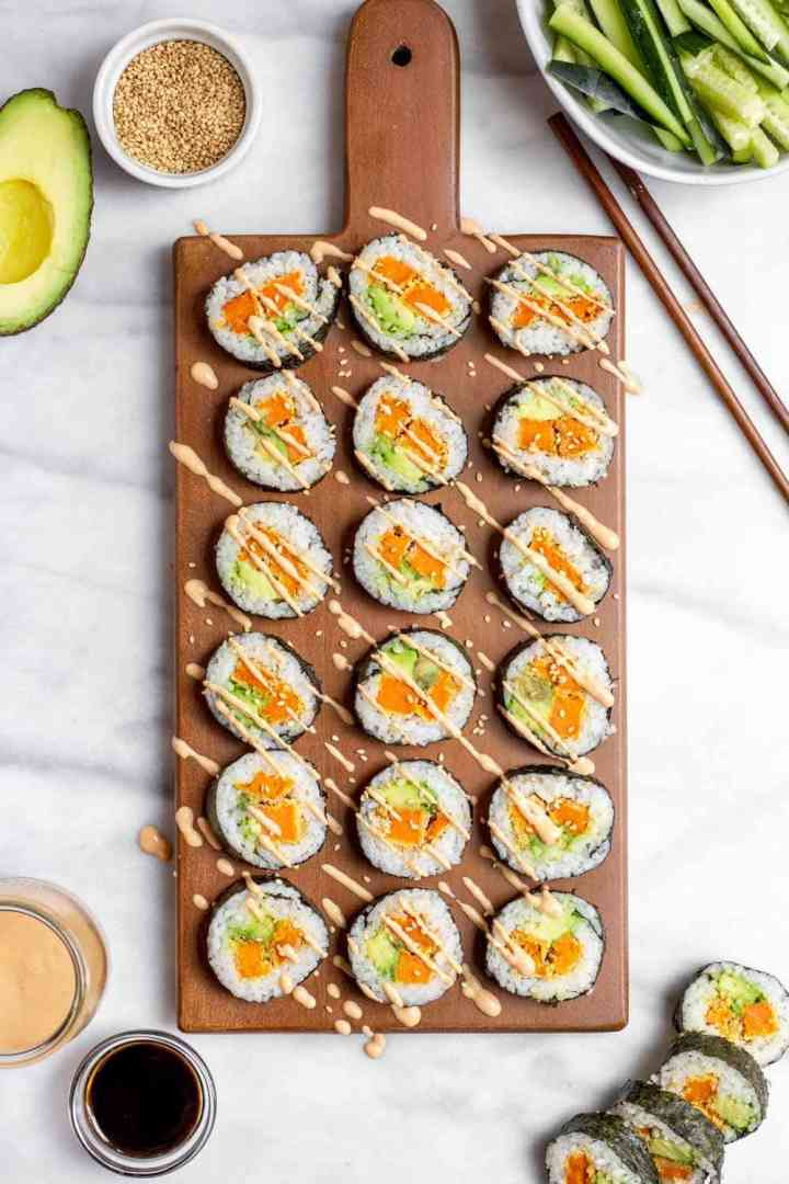 Vegetarian sushi recipe with sweet potato on a wood board.
