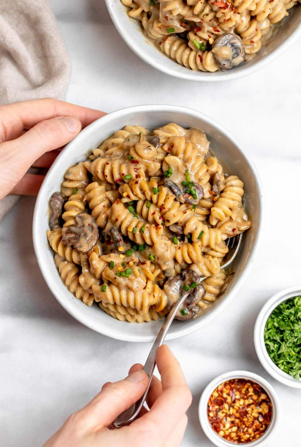 Vegan mushroom stroganoff in small bowls with parsley on top.
