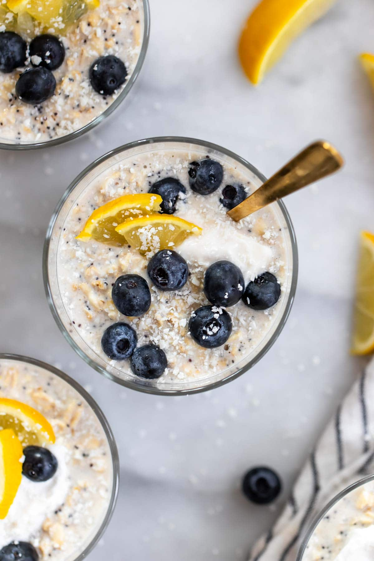 Overhead show of the overnight oats with yogurt and blueberries on top.