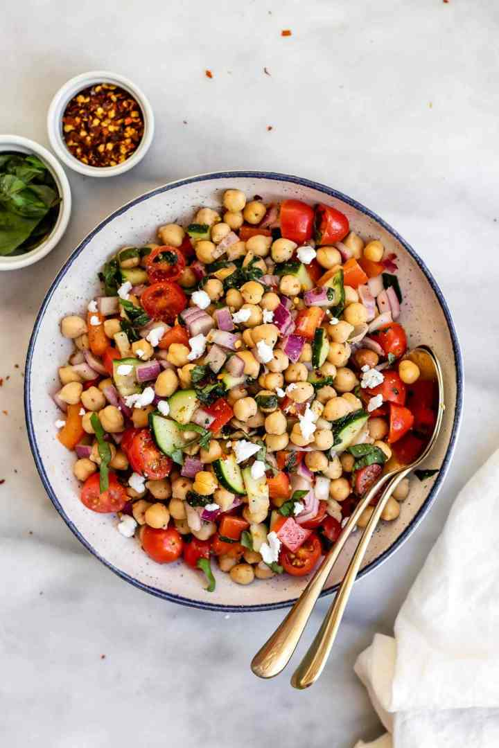 Mediterranean chickpea salad with crumbled feta on top.