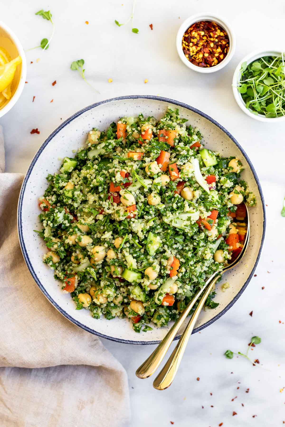 Gluten free quinoa tabbouleh salad in a large blue bowl.