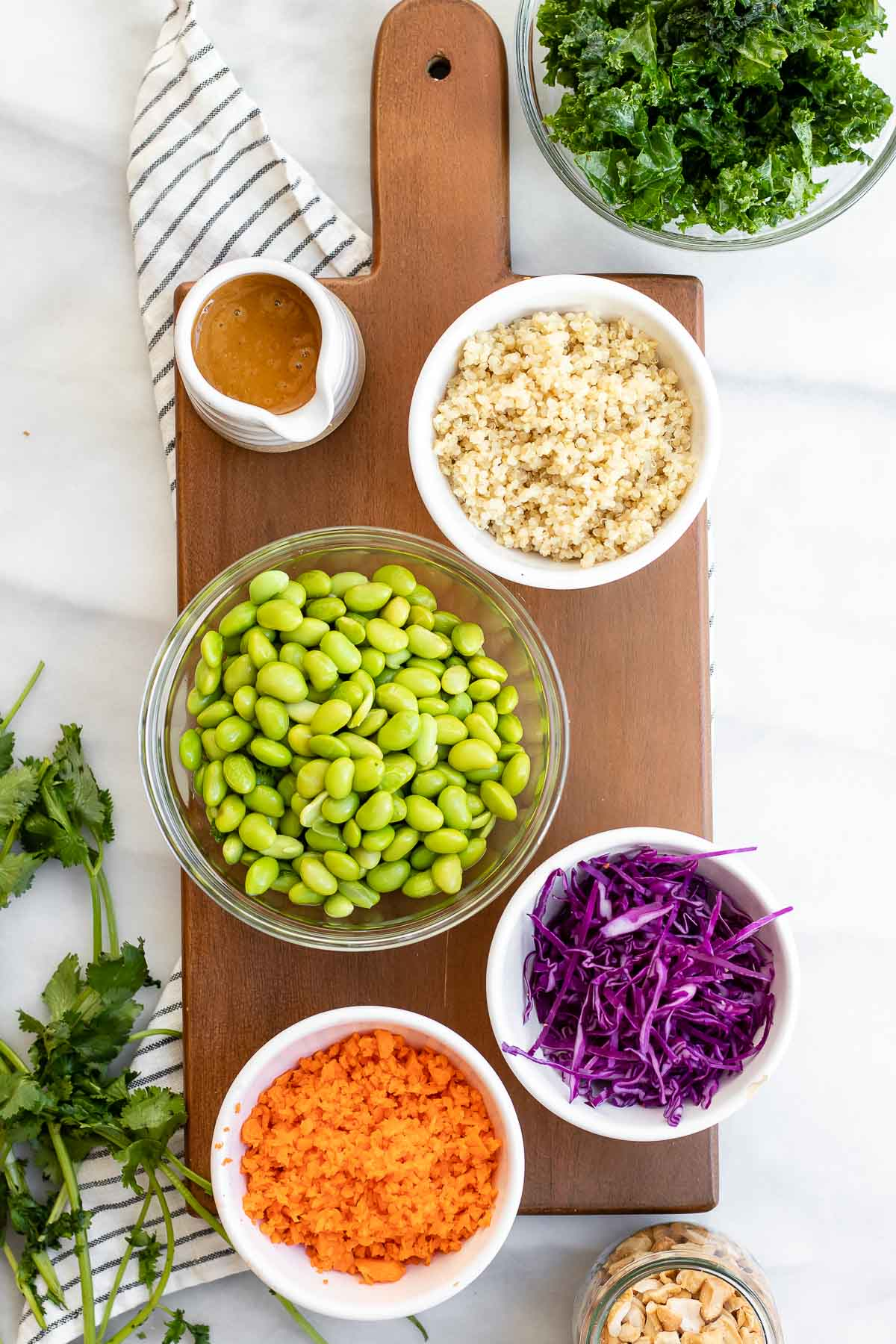 Ingredients for the salad on a wood board.
