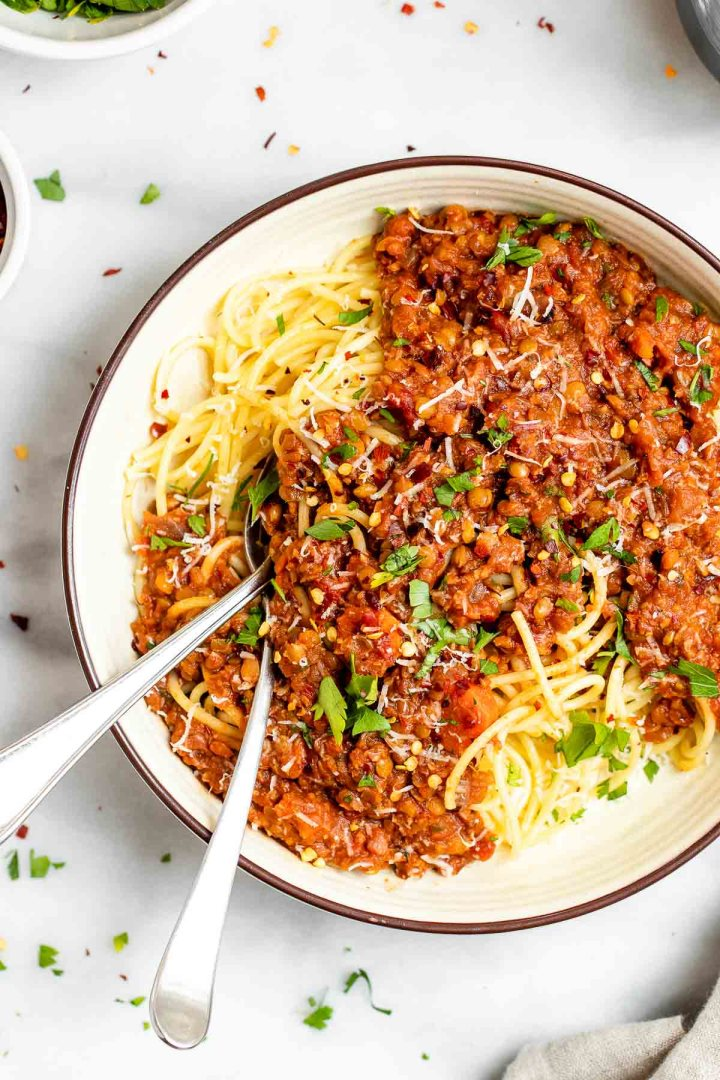 Up close shot of the spaghetti bolognese with two forks on the side of the bowl.