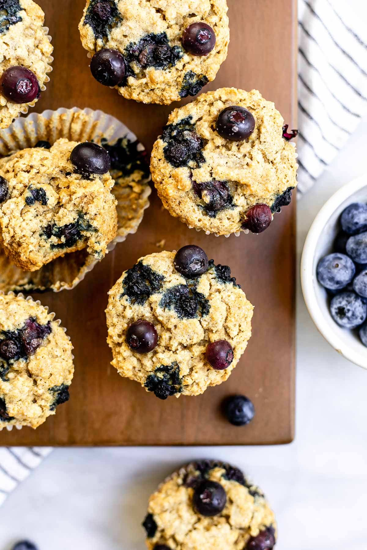Overhead shot of the oatmeal muffins with blueberries on top.