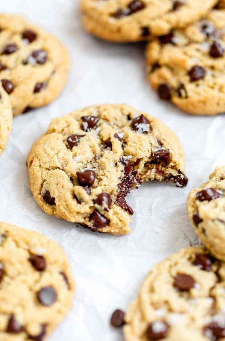 Almond flour cookies with chocolate chips on parchment paper.