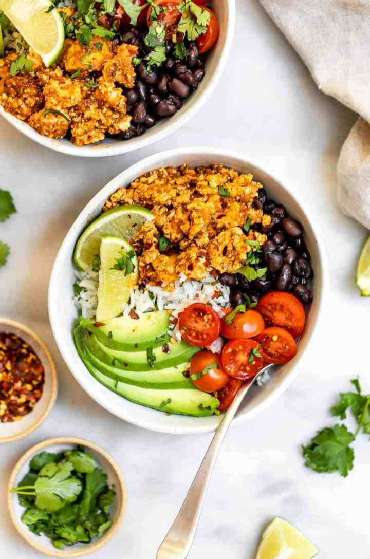 Chipotle sofritas in a bowl with veggies, rice and lime juice.