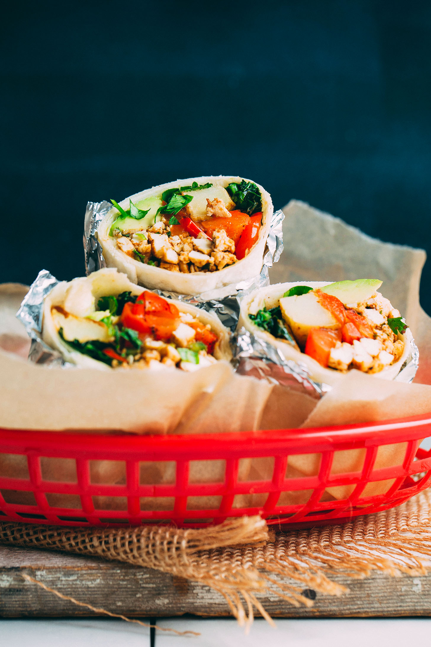 Vegan breakfast burrito in a red tray.