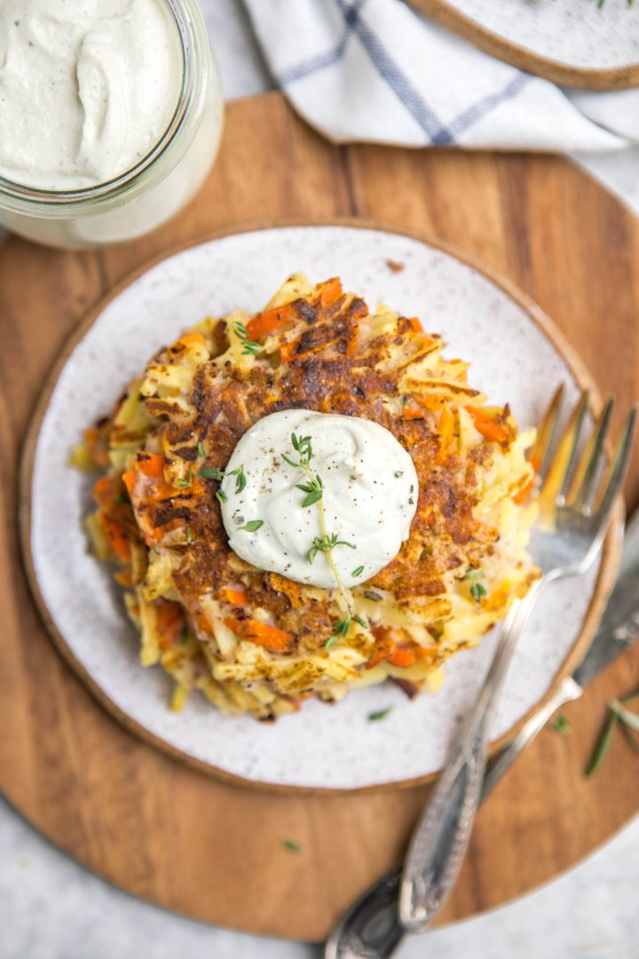 Root vegetable pancakes with sour cream.