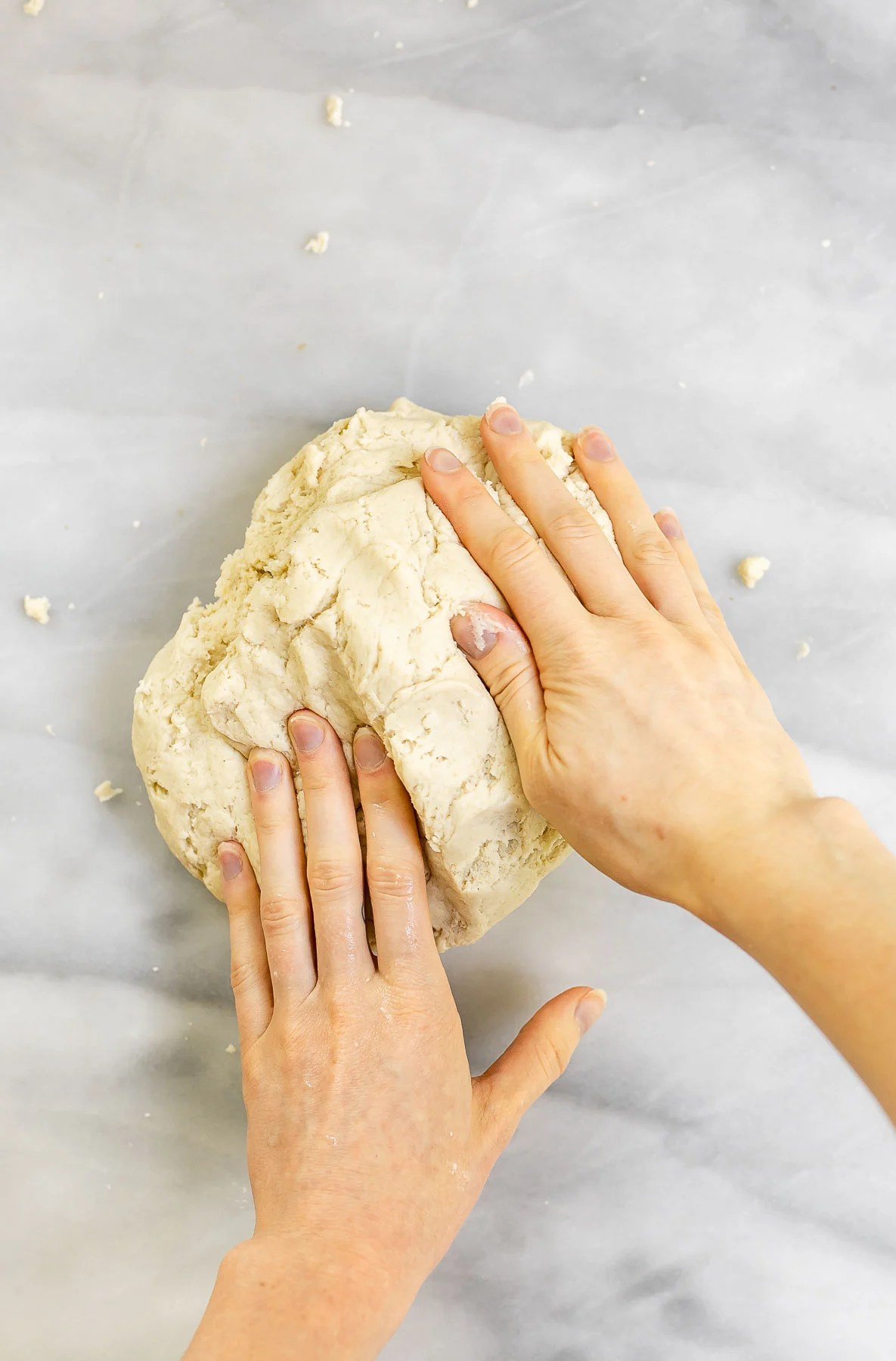 Kneading the bagel dough.