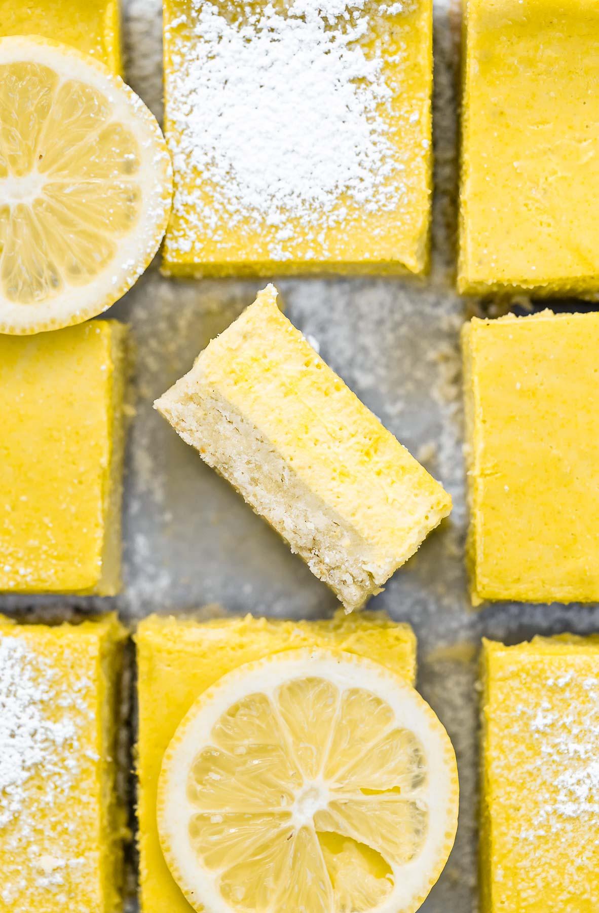 vegan lemon bars with sliced lemons on top