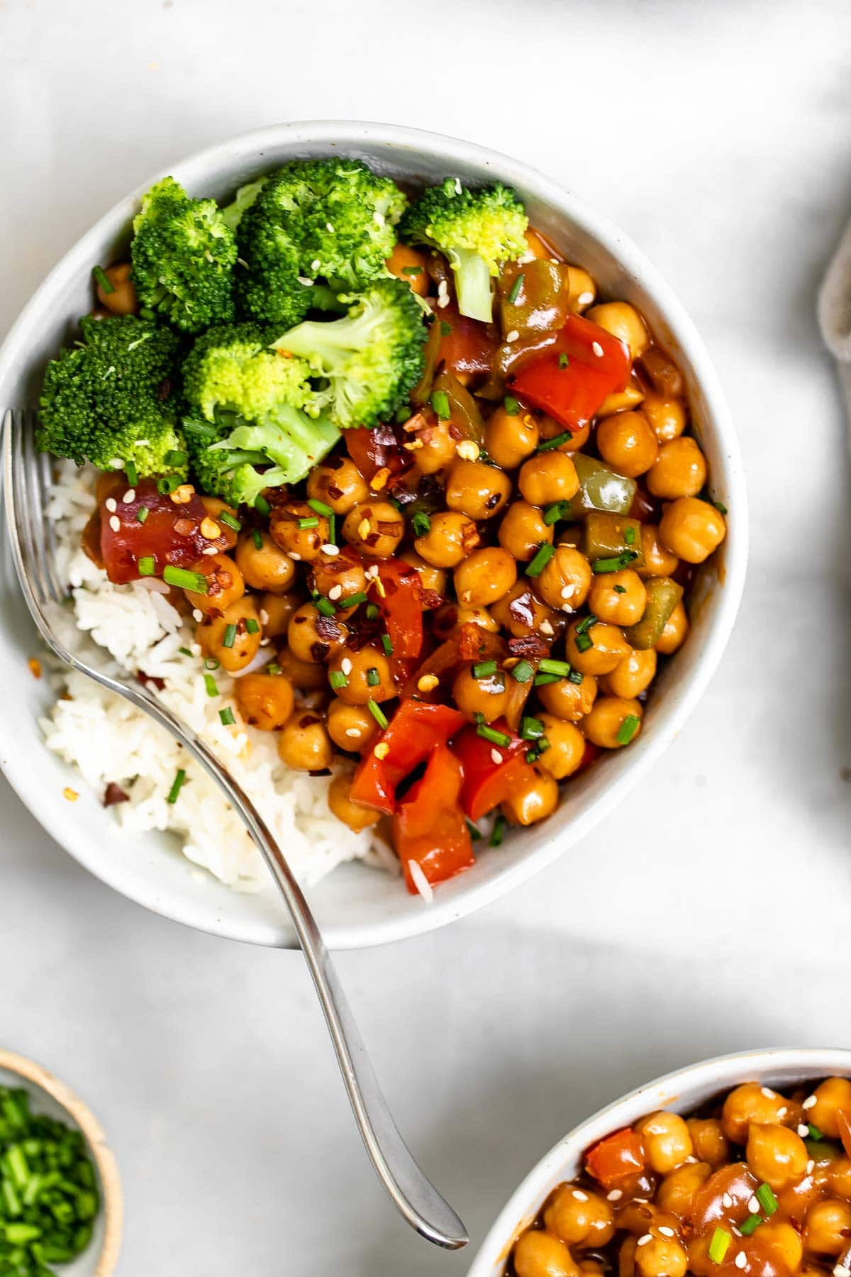 Chickpea stir fry with a fork on the side.