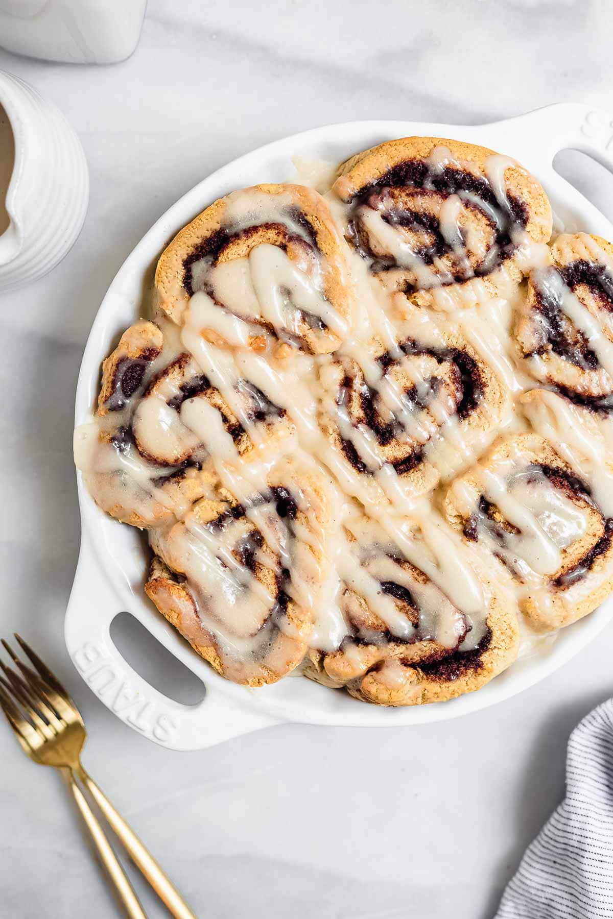 vegan and gluten free cinnamon rolls in a round pie dish.