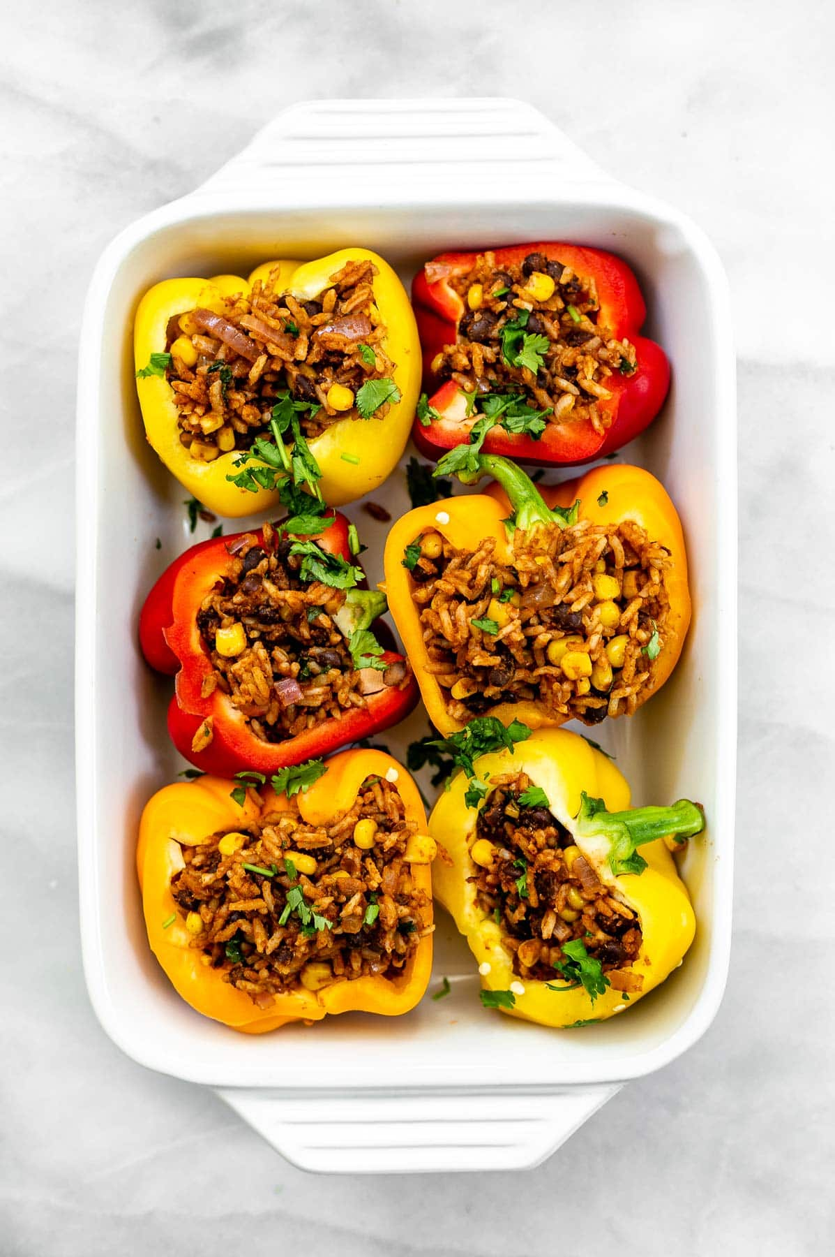 Vegan stuffed peppers before going in the oven.