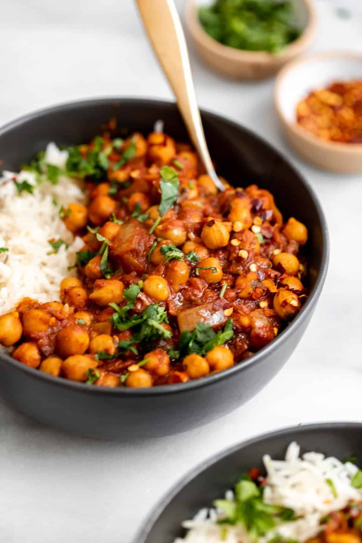 chana masala in a bowl with rice