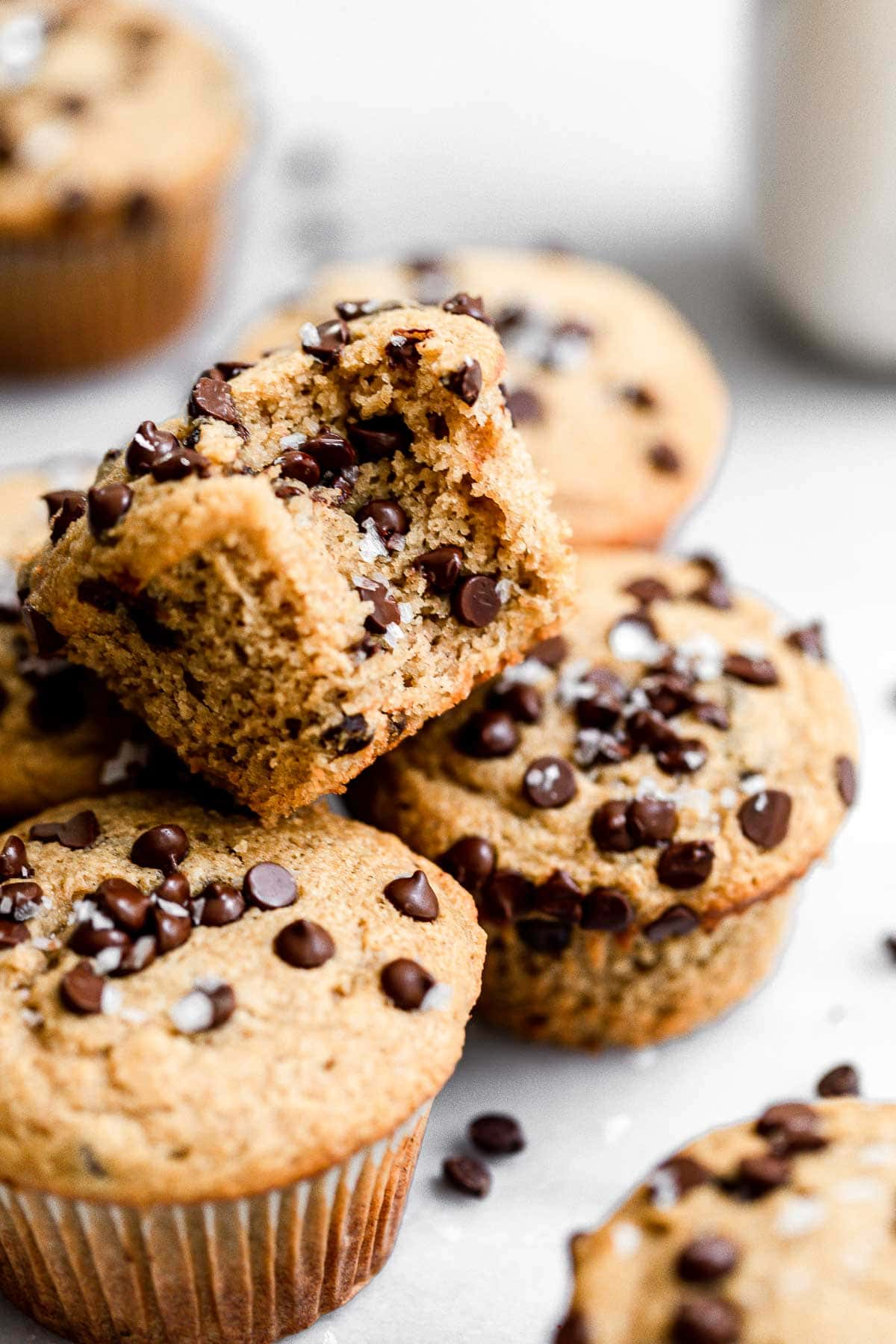 Chocolate chip banana muffins stacked on top of each other.