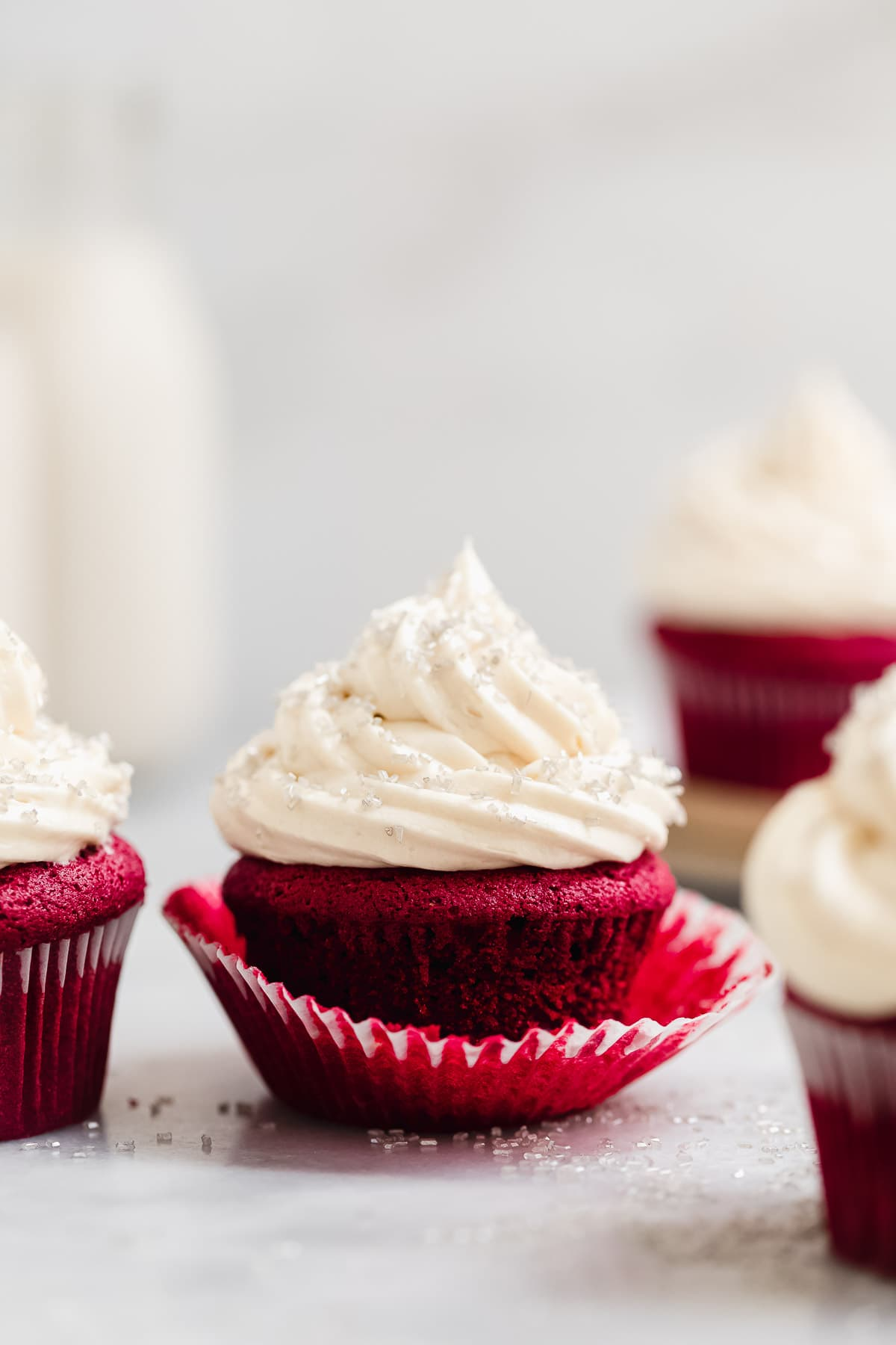vegan red velvet cupcakes with milk in the background