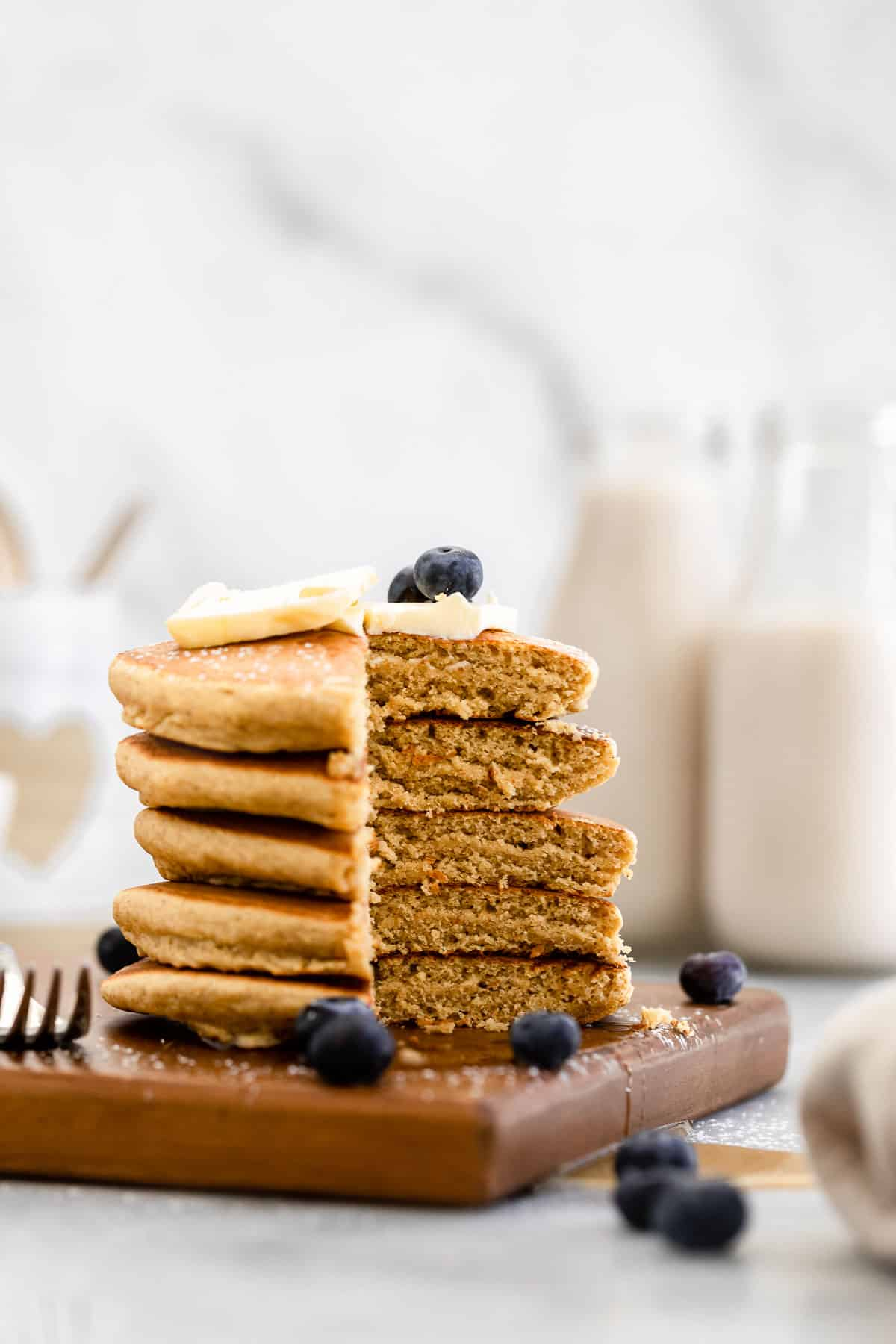 stack of chickpea flour pancakes with a bite cut out