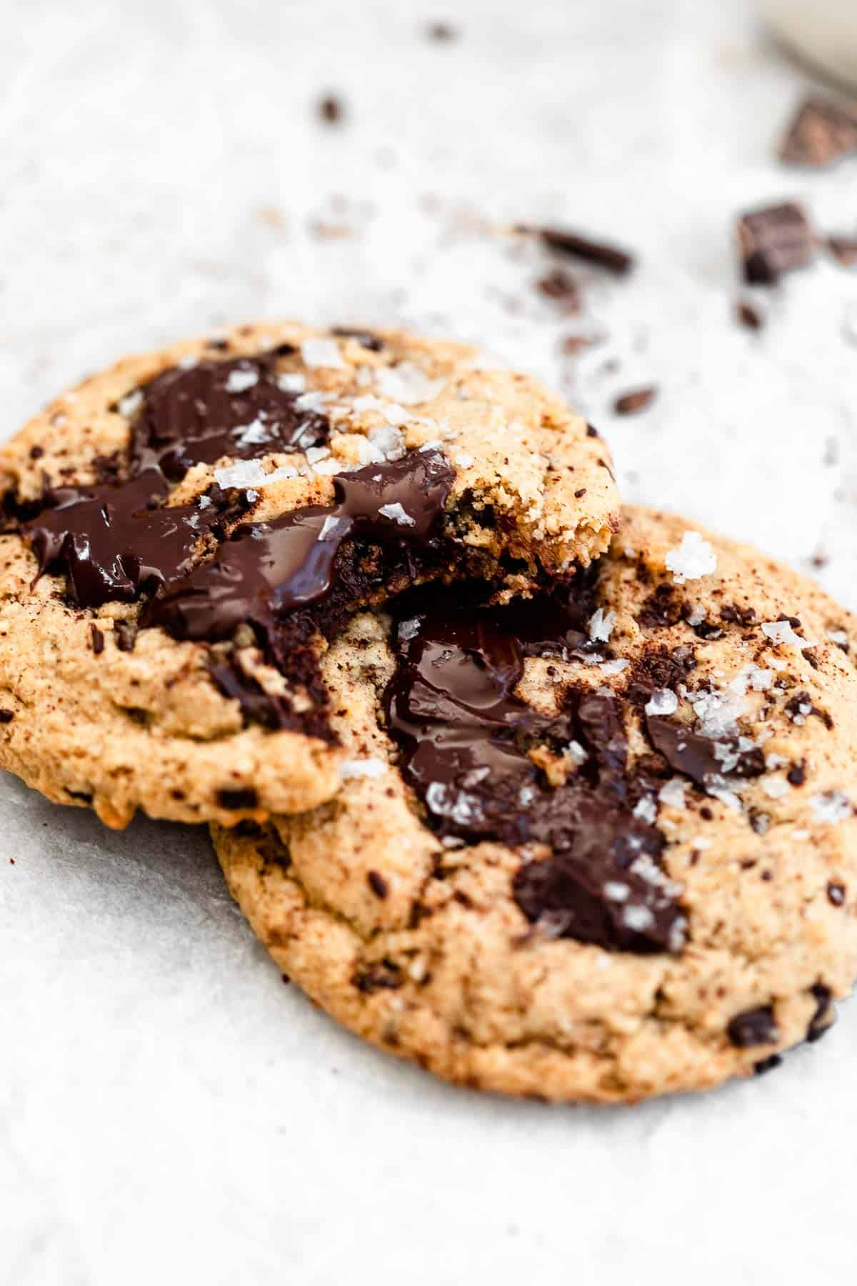 two paleo cookies with melted chocolate chunks