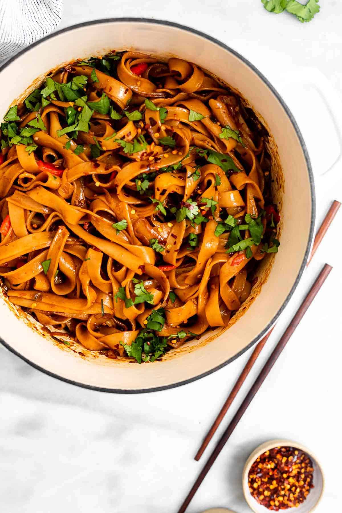 chili garlic noodles in a large white pot