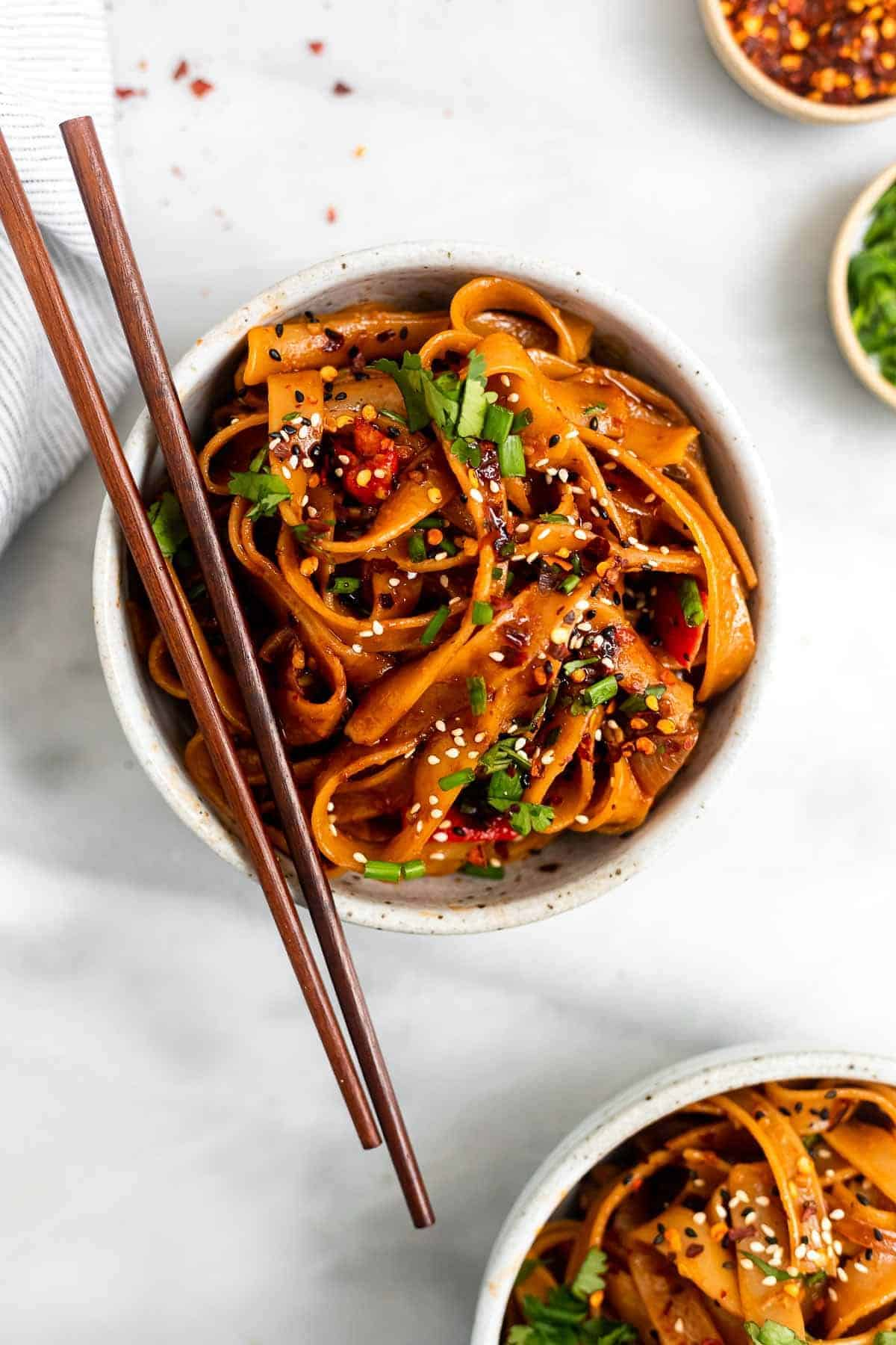 spicy chili garlic noodles in a bowl with chopsticks