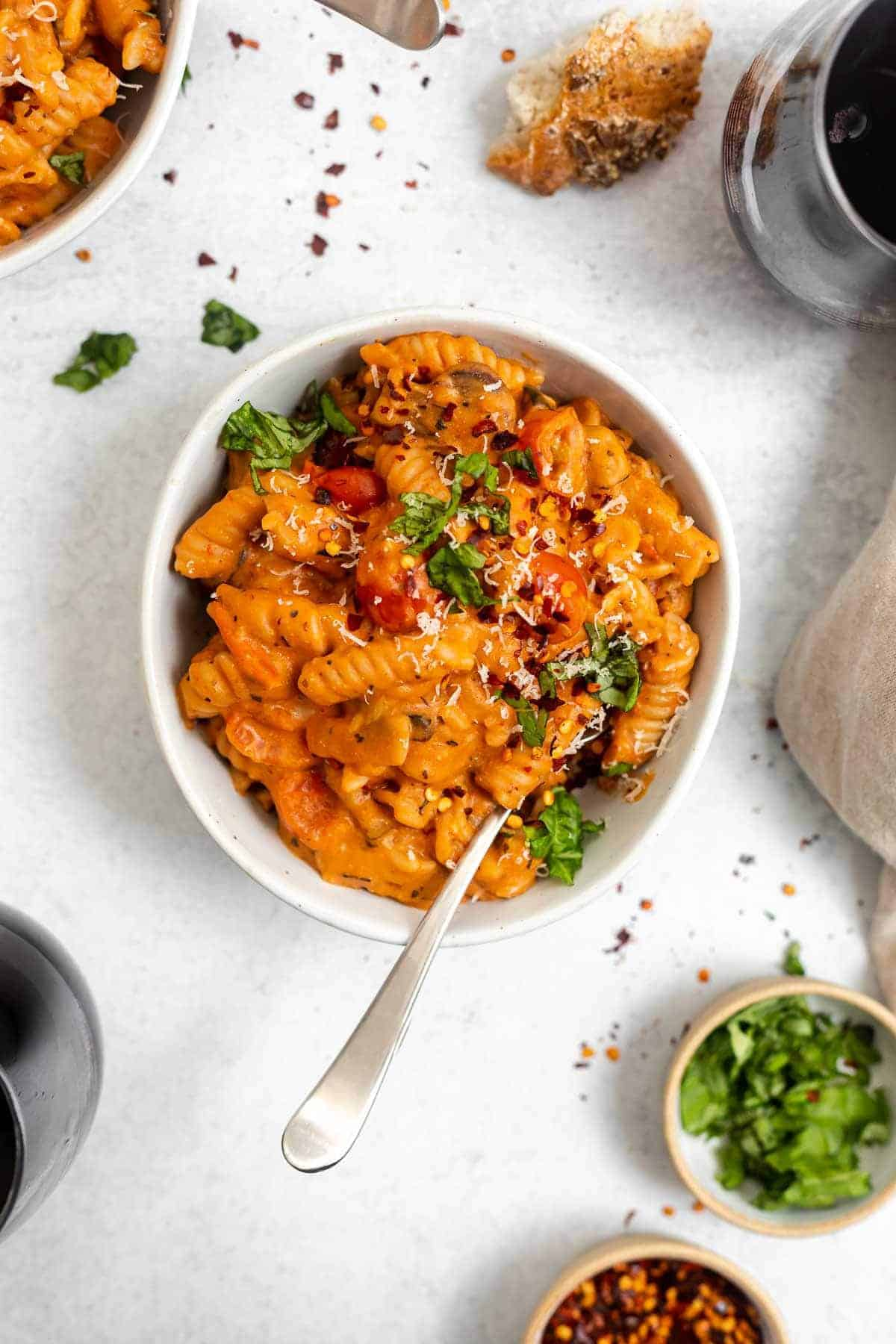 vegan one pot pasta in a small bowl with basil on top