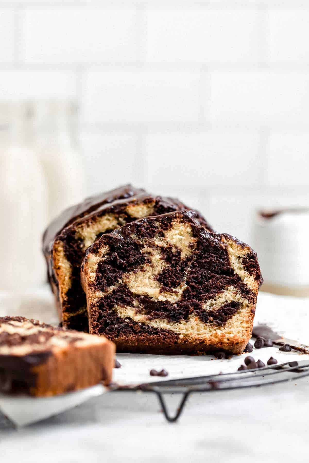 marble loaf cake on a wire rack with milk in the background