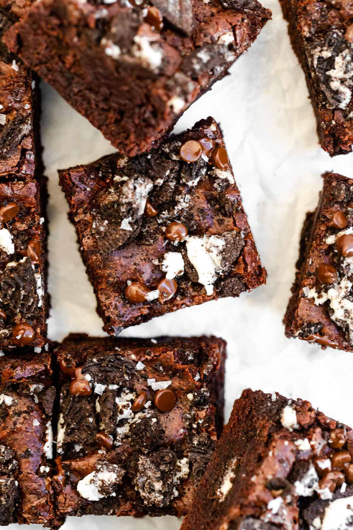 oreo brownies cut into squares with chocolate chips on top