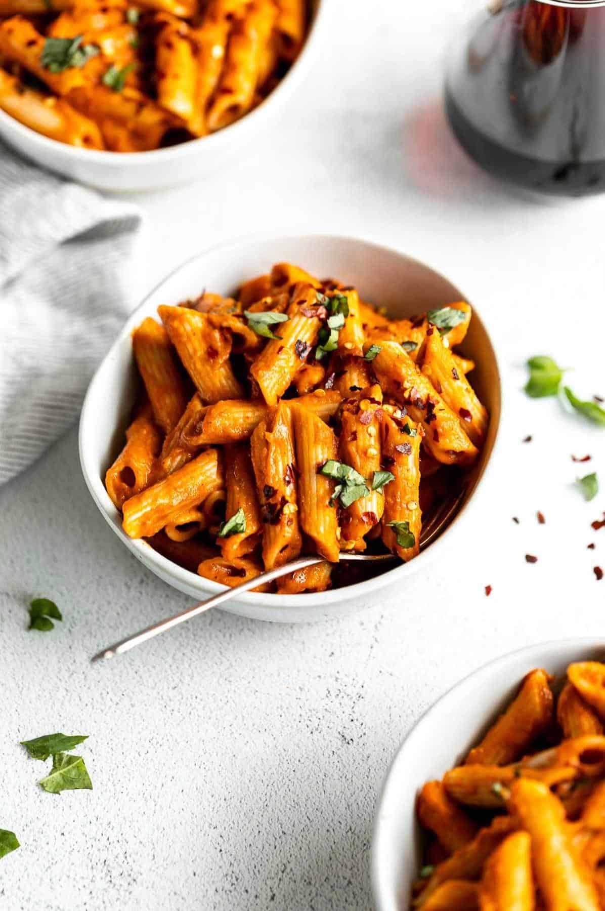 three bowls of pasta with the vegan pasta sauce