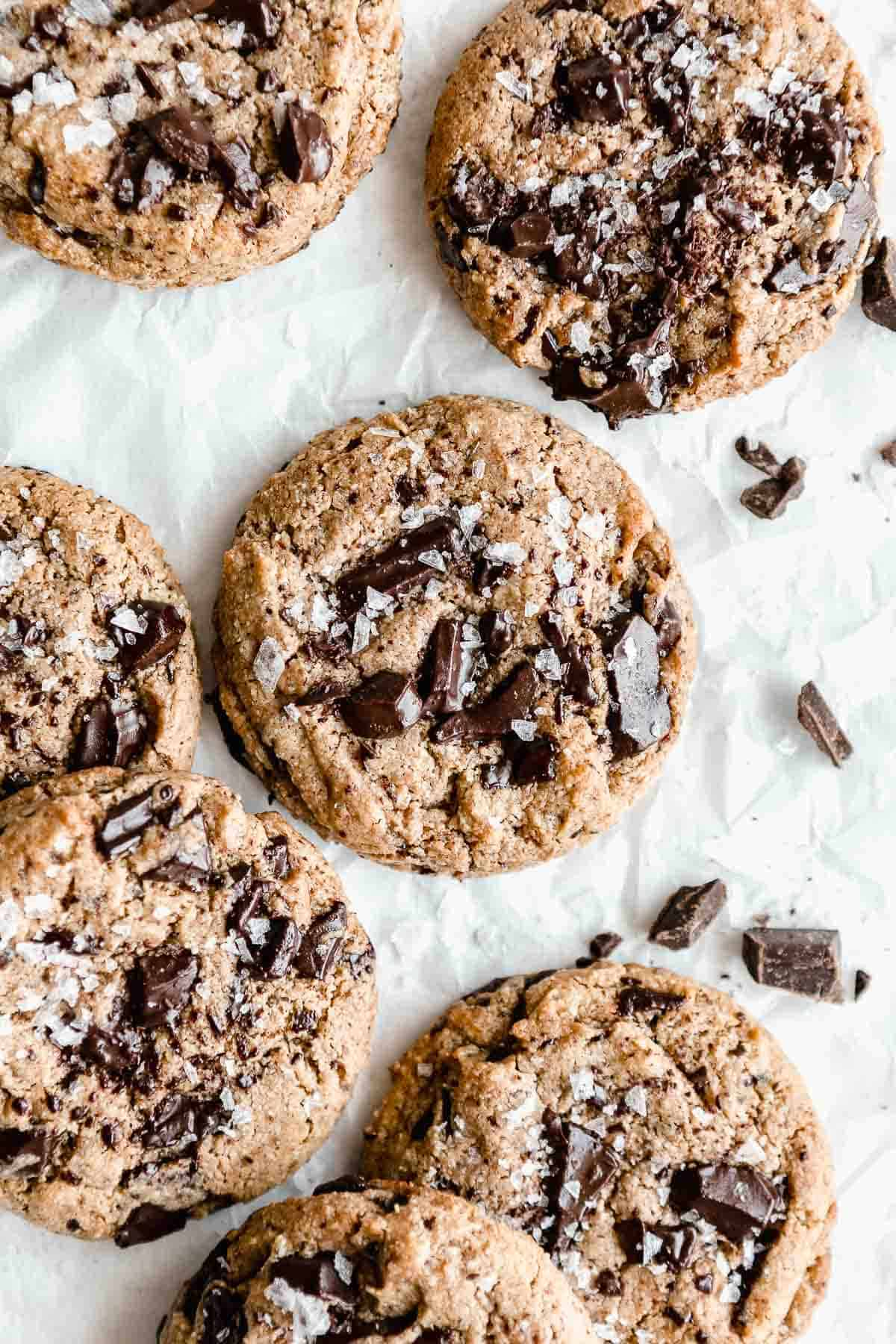 vegan protein cookies with chocolate chunks on parchment paper