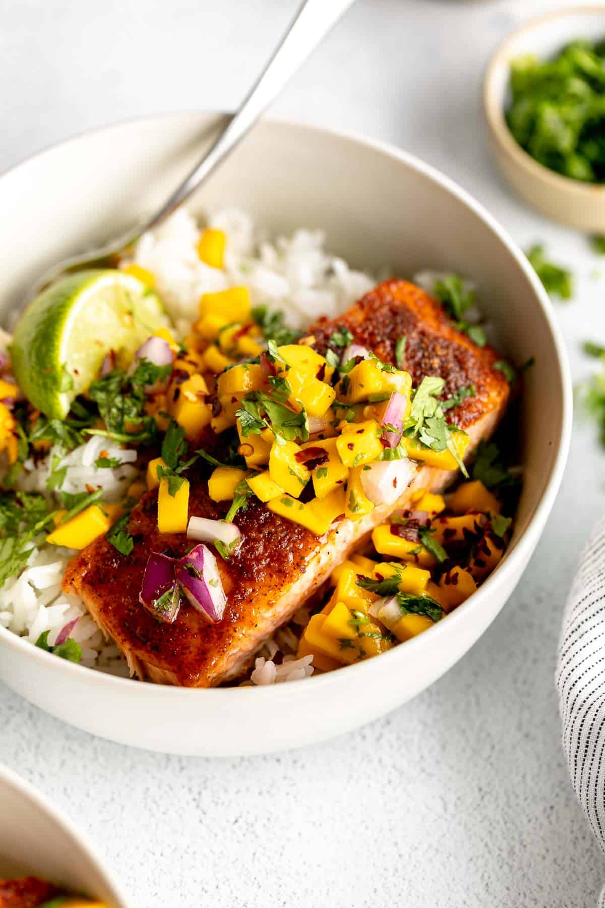 baked cajun salmon with mango salsa in a bowl