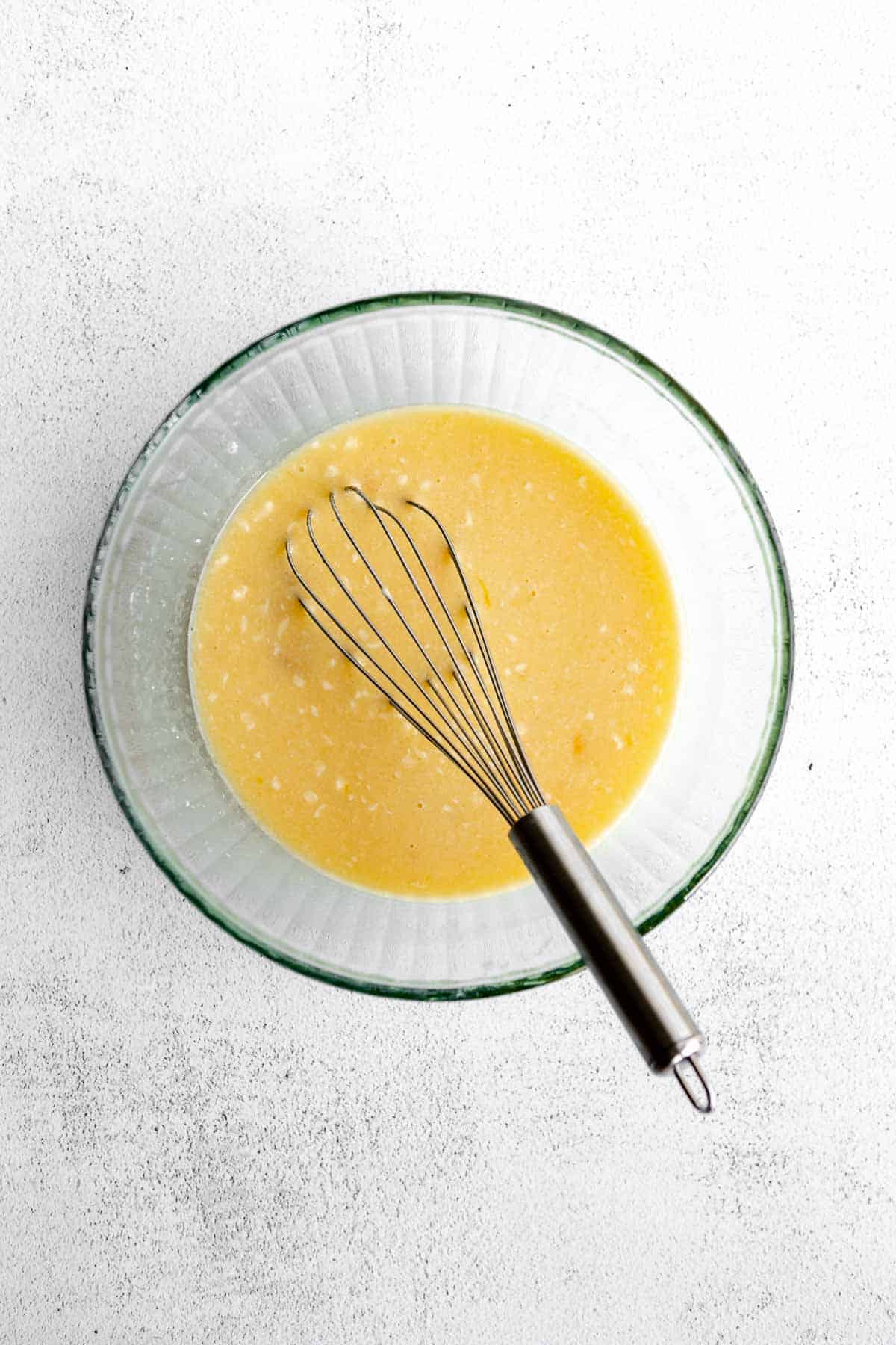 wet ingredients in a bowl with a whisk