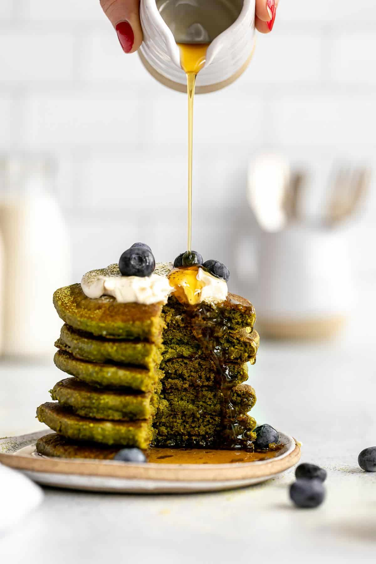 stack of match pancakes with a bite cut out to show texture