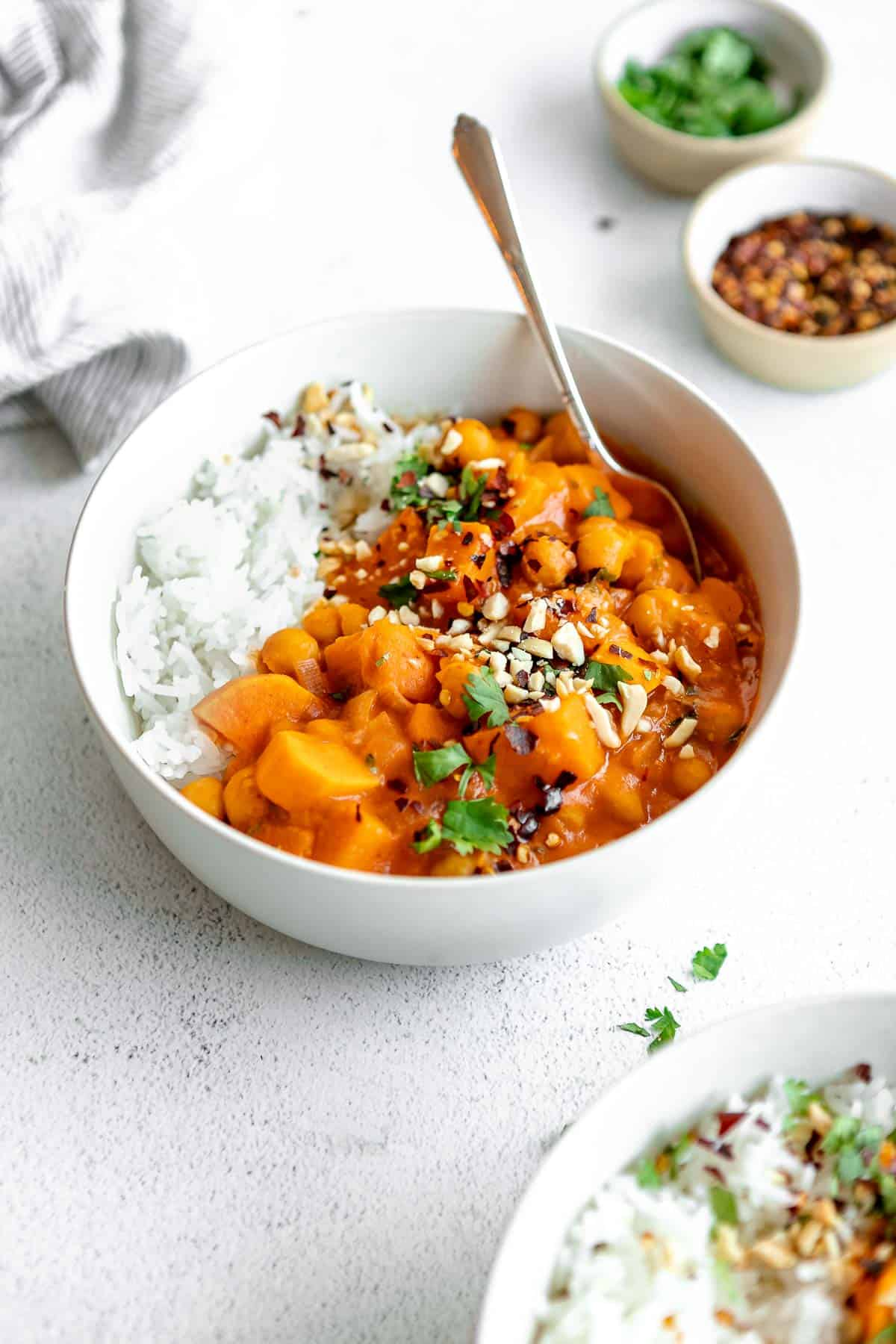vegan sweet potato chickpea curry with white rice and peanuts