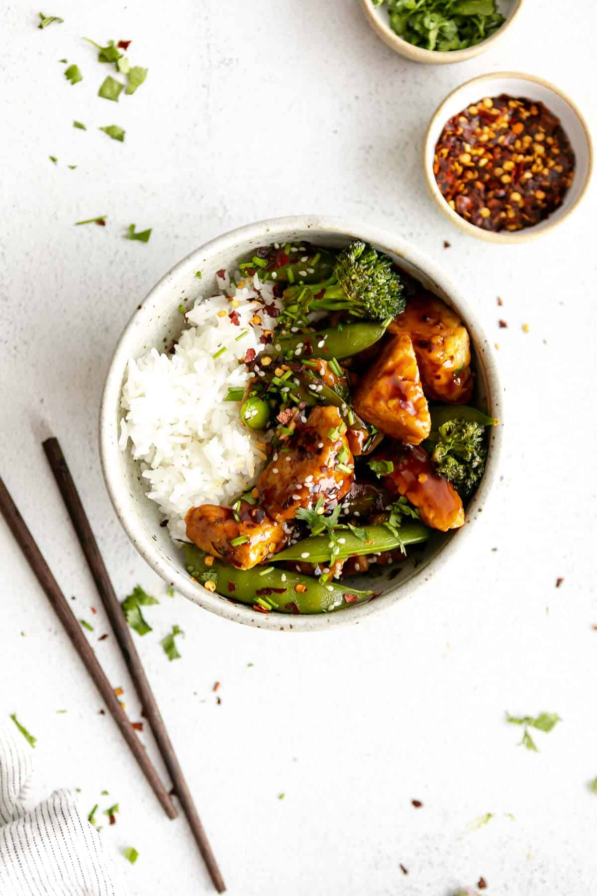 tempeh stir fry with broccoli and rice in a bowl