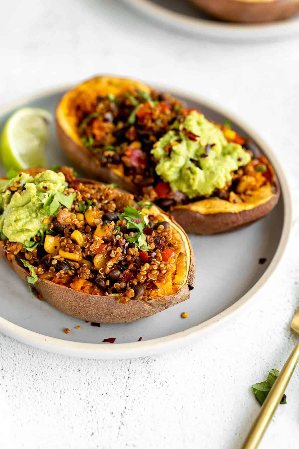 vegan mexican quinoa stuffed sweet potatoes with guacamole
