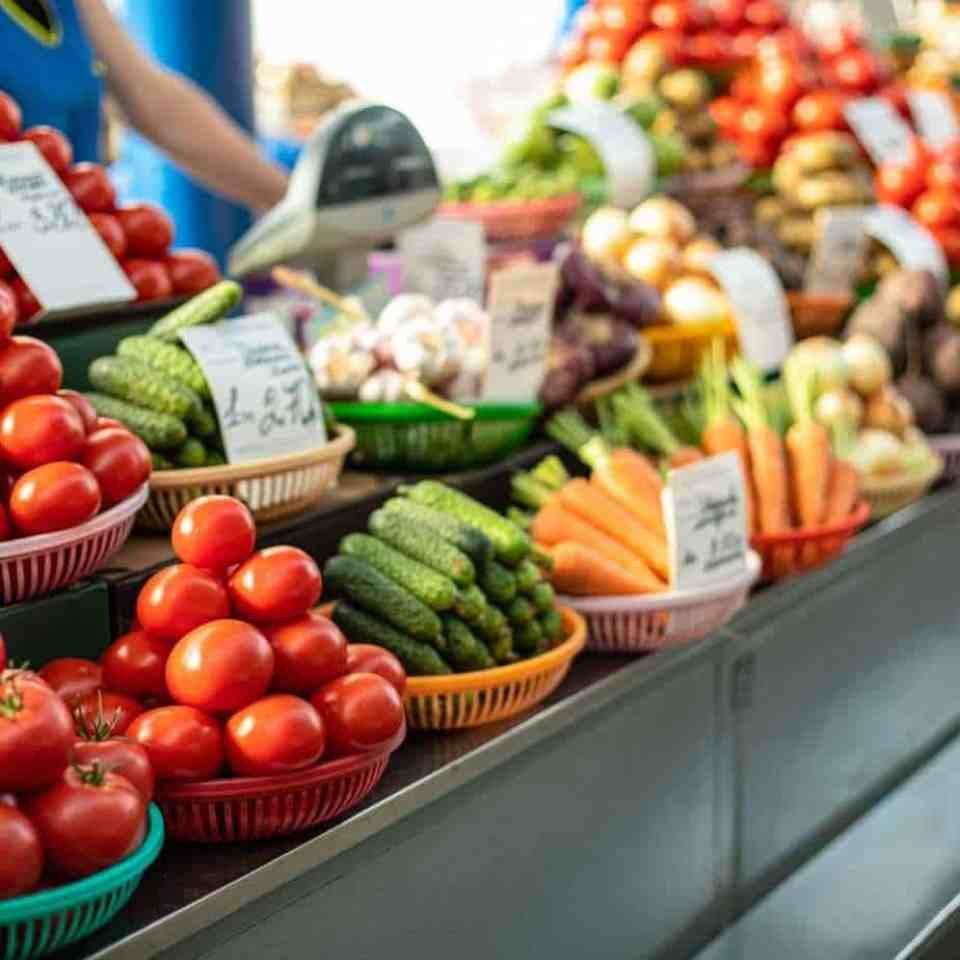 Healthy fruits and vegetables on a clearance section of the grocery store.