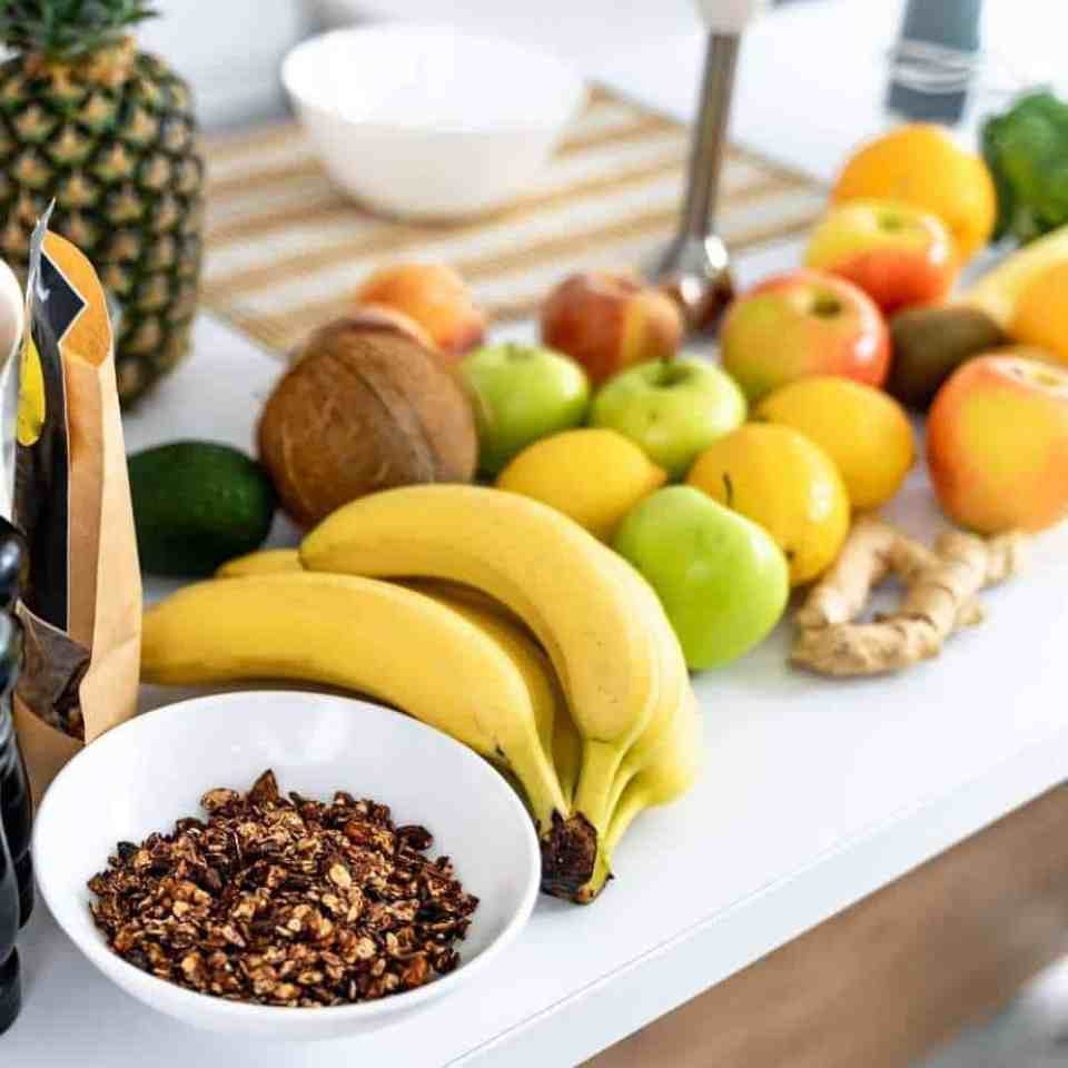 Healthy fruits such as bananas, ginger, apples. lemon and granola from a healthy shopping trip full of tips for busy person.