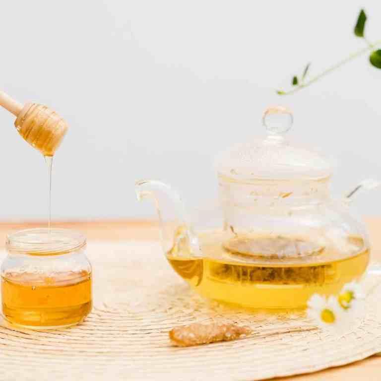 Honey cinnamon hot tea drink recipe in a glass teapot.