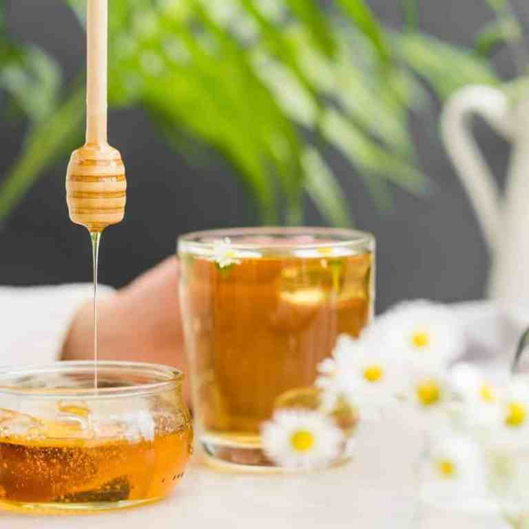 Does manuka honey boost your immune system? Manuka honey in a glass container.