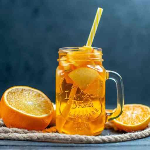 Honey cinnamon orange drink in a mason jar glass.