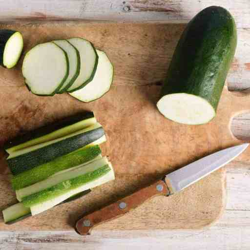 Cut zucchini on a cutting board. Benefits of eating raw zucchini.
