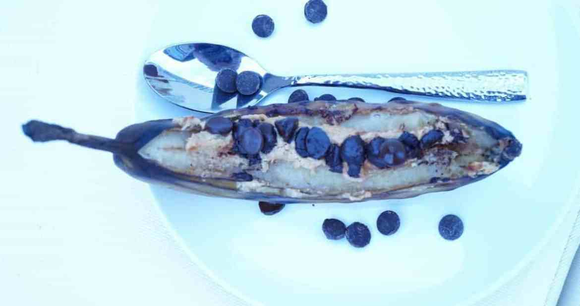 A paleo dessert worthy of every summer BBQ and cookout. Grilled bananas with peanut butter and chocolate morsels make a delicious, healthy and balanced dessert