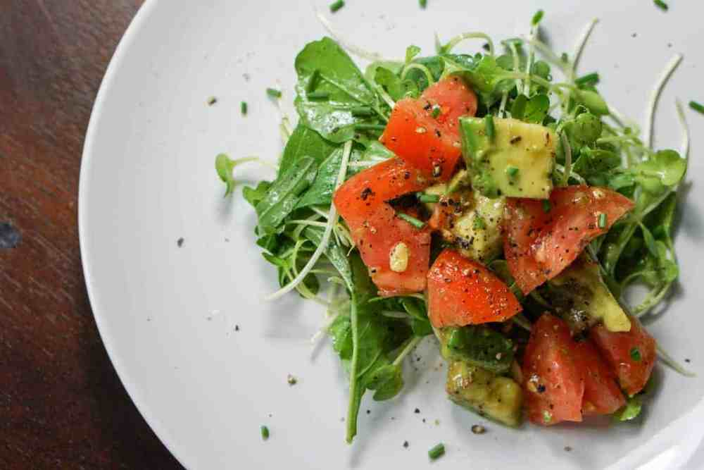 Quick, Easy and Nutritious Salad: Tomato and Avo on Arugula and Micro Greens