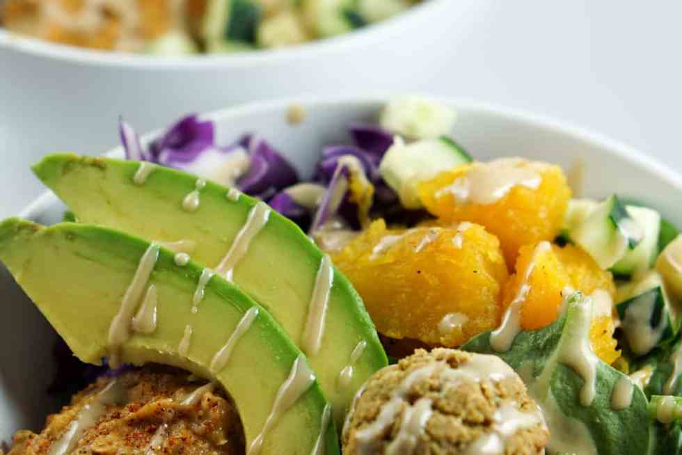 A savory alternative to salad, these quick and easy Falafel Bowls with roasted squash, avocado and harissa hummus recipe make a perfect healthy dinner.