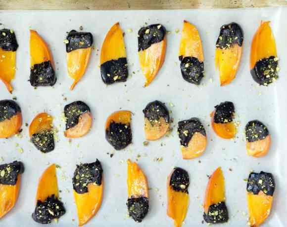 Chocolate Covered Persimmons with Crushed Pistachios