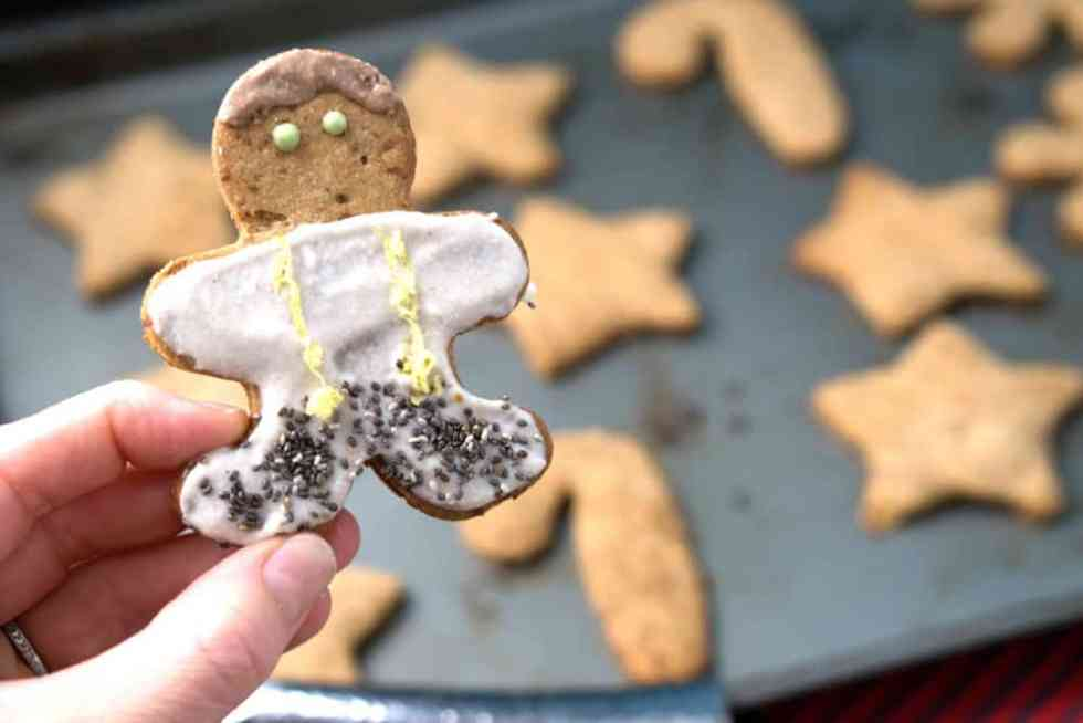 a healthy gingerbread man - made of gluten free cut out cookies and cashew date frosting!